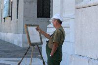kunstenaar Jacopo uit Budapest schildert San Marco vanaf San Giorgio